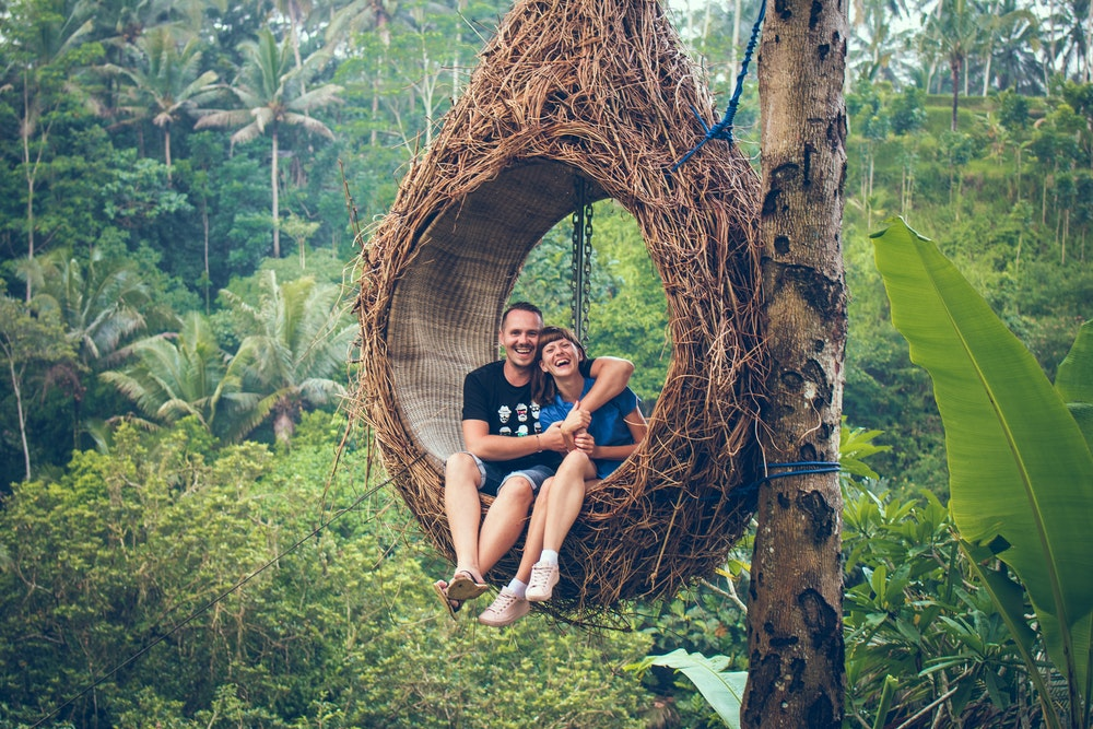happy couple on jungle swing
