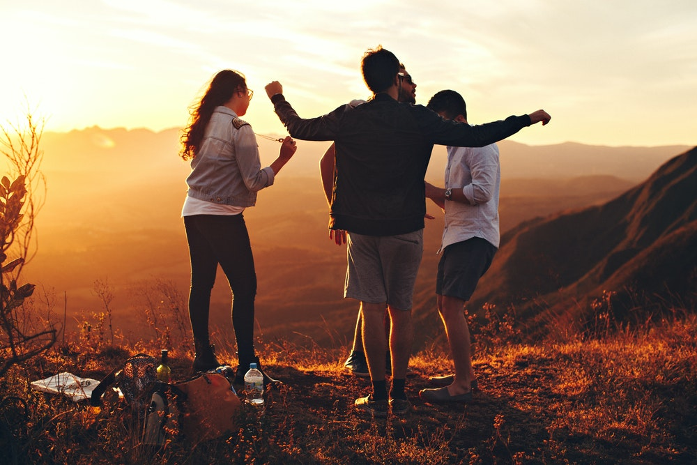 friends having fun on a mountain top