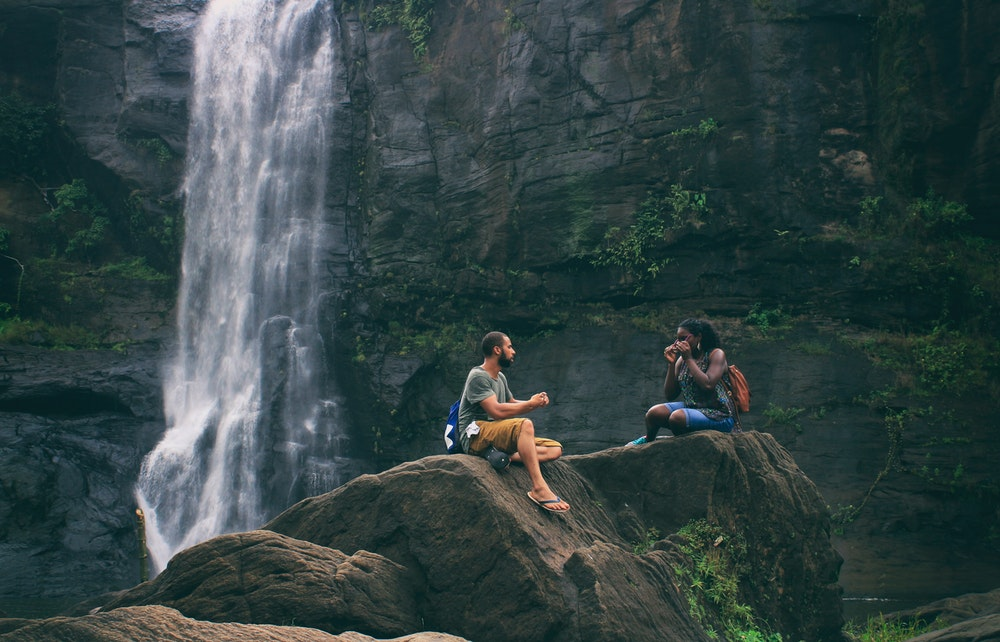 couple by a waterfall.